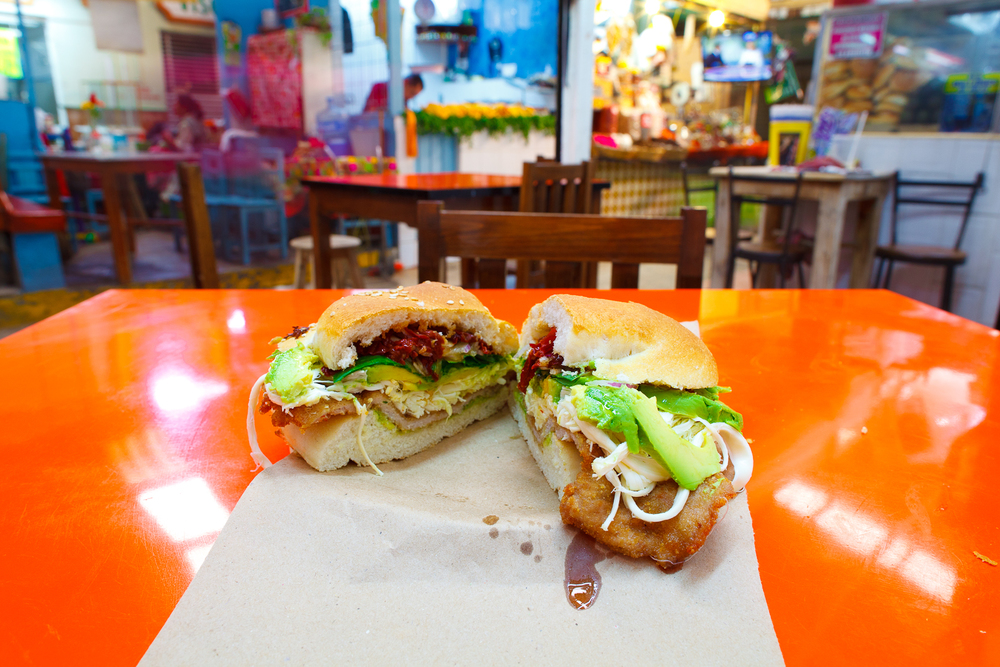 Cemita de milanesa con chipotle (breaded pork sandwich with pápalo, avocado, quesillo, chipotle) (30 MXP)