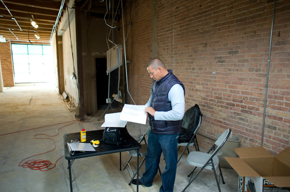 Chef Curtis Duffy looking through floorplans