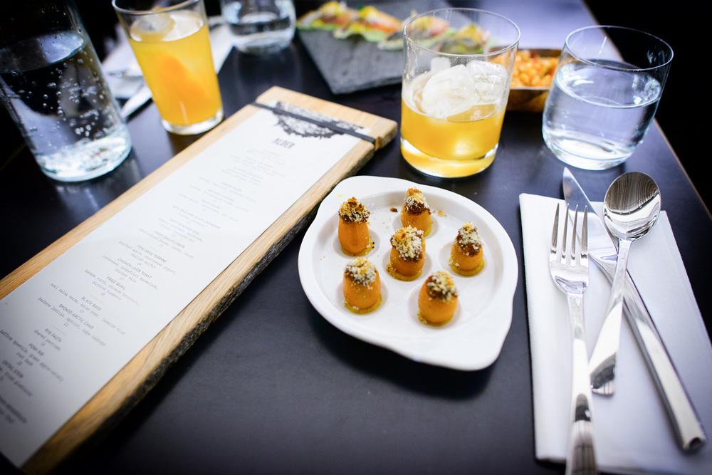Stuffed kumquats, parsnip-black sesame, merguez sausage
