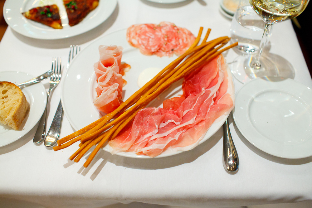 """Snacks: Prosciutto di San Daniele Riserva, Friuli, Italy; Speck, Alto Adige, Italy; Salame Toscano, Fra'mani, Berkeley, California, with """"Rafano"""" and """"Grissini"""""""