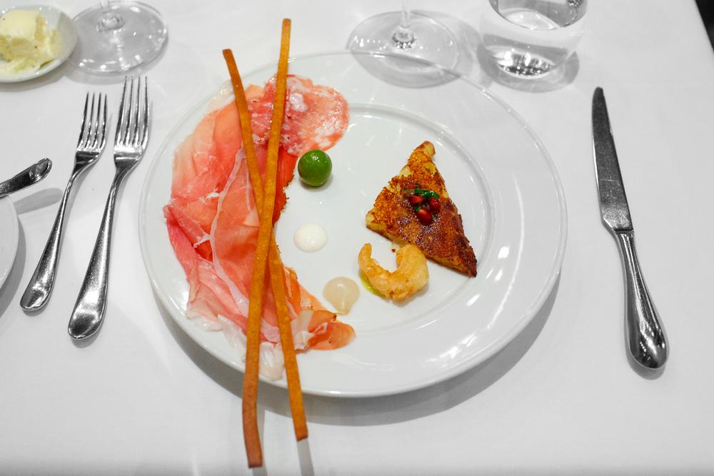 1st Course: Salumi - prosciutto di San Daniele Riserva (Friuli), Speck (Alto Adige), Salame Toscano, Fra'mani (Berkeley, CA), served with Rafano and Grissini. Frico caldo, gamberetti, olives.