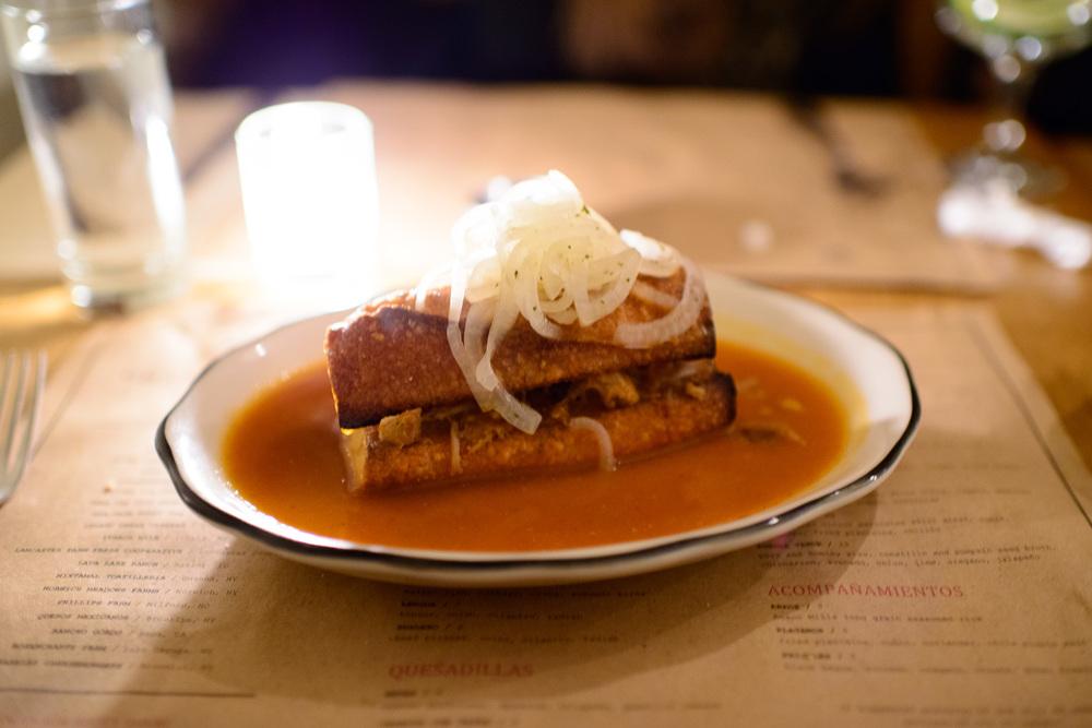 Torta ahogada - roast pork, ahogada sauce, onion ($13)