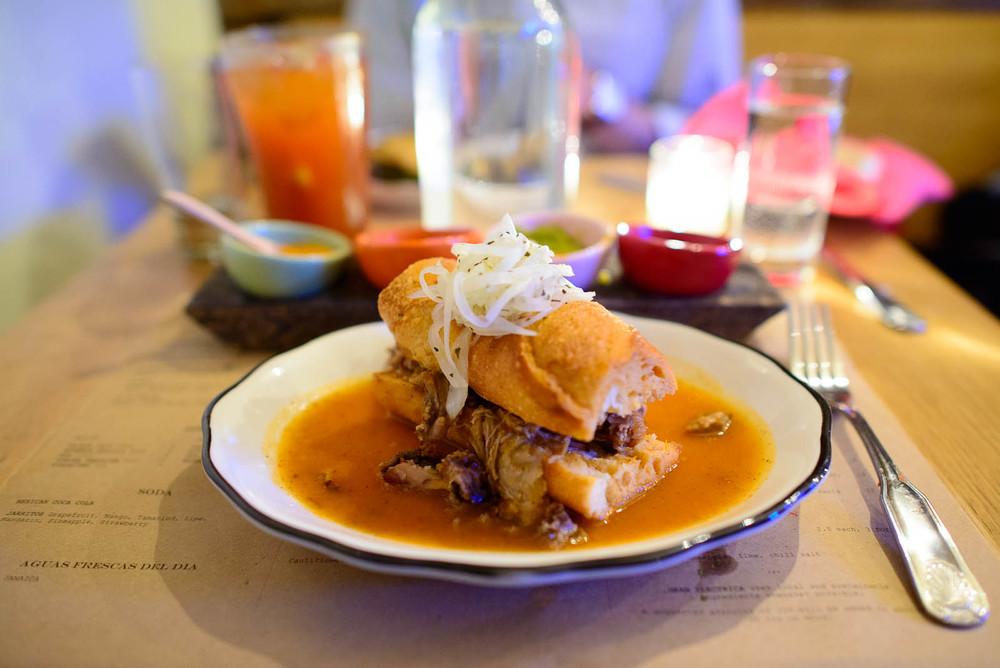 "Torta ahogada (""drowned sandwich"") - roast pork, ahogada sauce,"