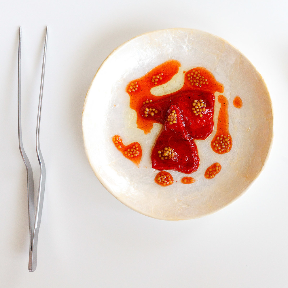 "4th Course: ""Piquillo pepper"" - Dehydrated watermelon re-hydrated in charred piquillo sauce, mustard seeds"