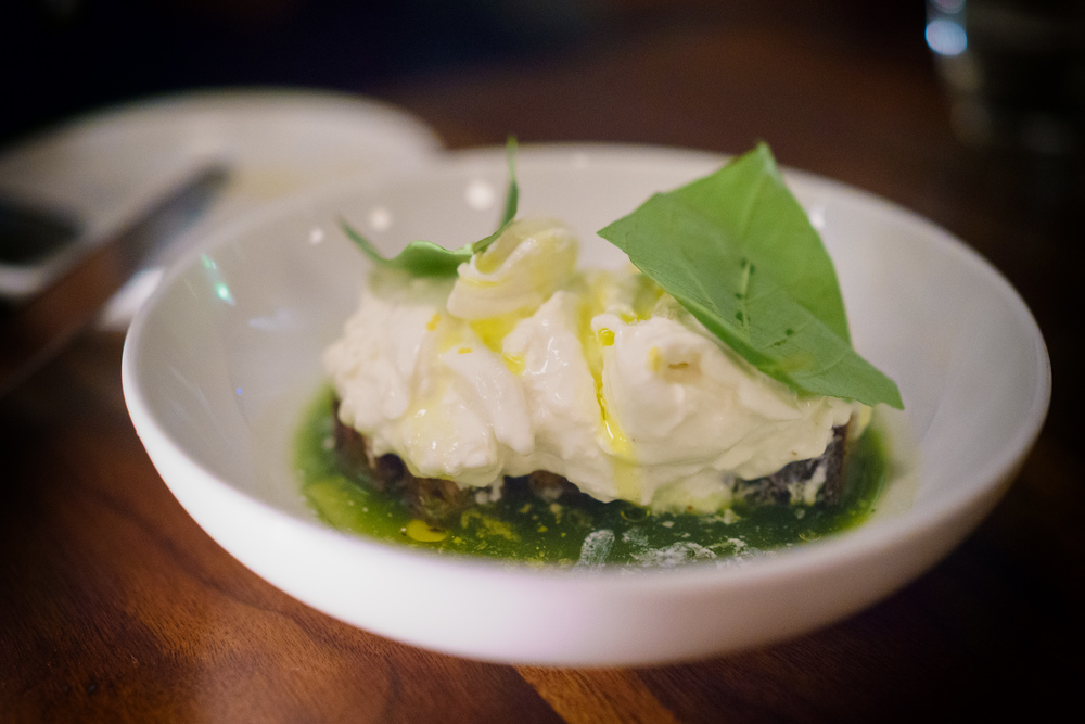 Burrata with salsa verde and charred bread ($17)