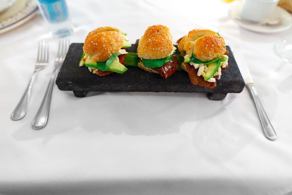 La trilogía de cemitas - el tradicional pan poblano en versión mini preparados pipián verde, chile relleno, y carne enchilada (3 small sandwiches from Puebla: green pipián, stuffed pepper,breaded meat