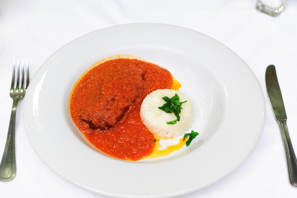 El chile ancho relleno de queso - tradicional chile relleno de queso de cabra, bañado en salsa de jitomate (ancho chile stuffed with goat cheese in tomato sauce)