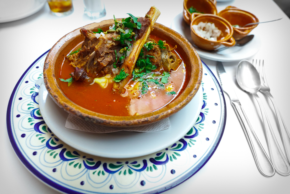 Huaxmole de Puebla (garnished)- Goat stew with onion, local squash seeds, and cilantro
