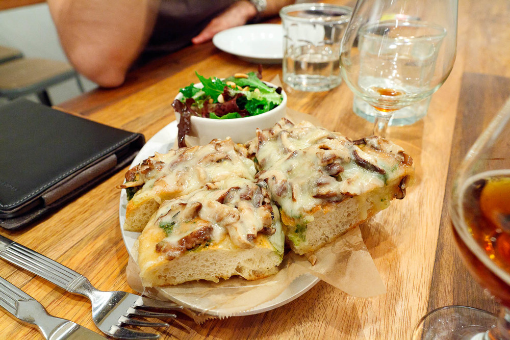 Fontina Val d'Aosta - Marinated mushrooms and basil pesto open-face on focaccia with green salad and toasted pine nuts ($11)