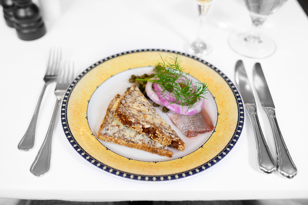 Pickled barrel herring from Iceland, capers and onions