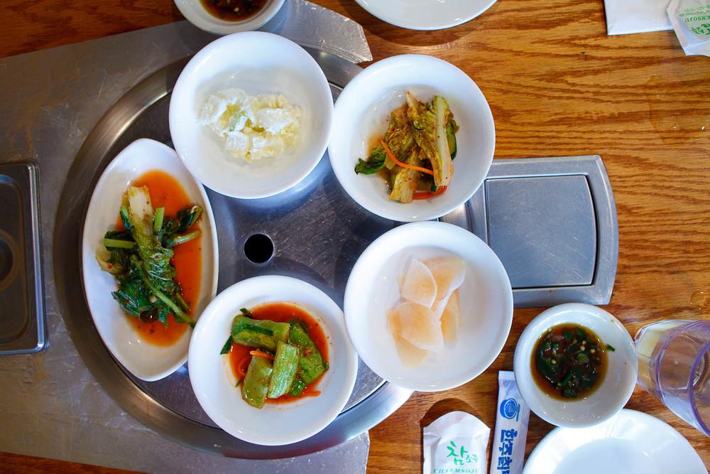 Banchan assortiment - gamja jorim (potato salad), kim chi, mu kimchi, oi sobaeji (cucumber kimchi), yeolmu kimchi (young radish kimchi)