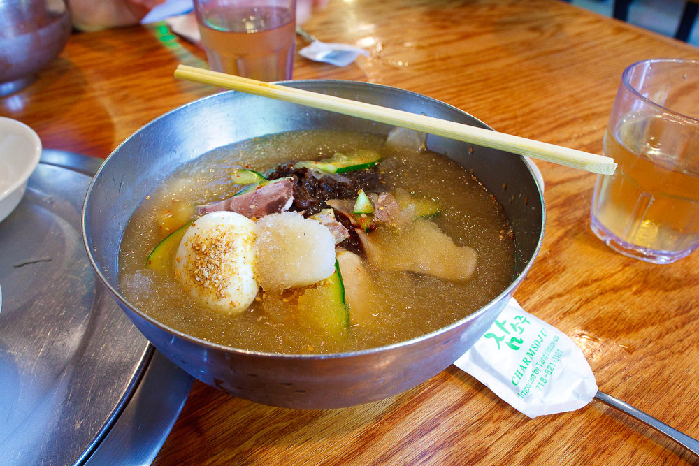 Mul Naeng Myun - Arrowroot starch noodles, sliced beef & vegetables in chilled beef broth, revealing noodles ($8.95)