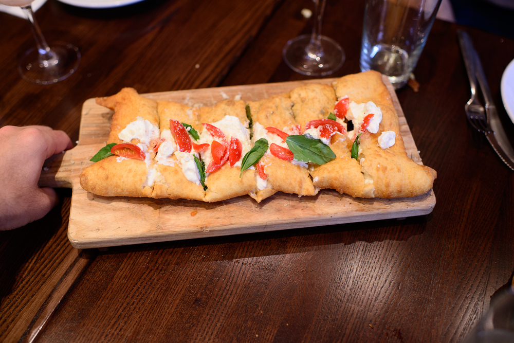 Calzone fritto - filled with escarole, gaeta olives, pine nuts a