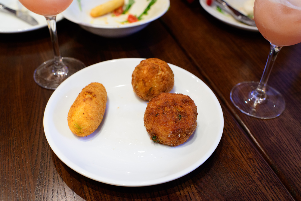 Arancini (Neapolitan rice ball with baked Italian ham) with pota