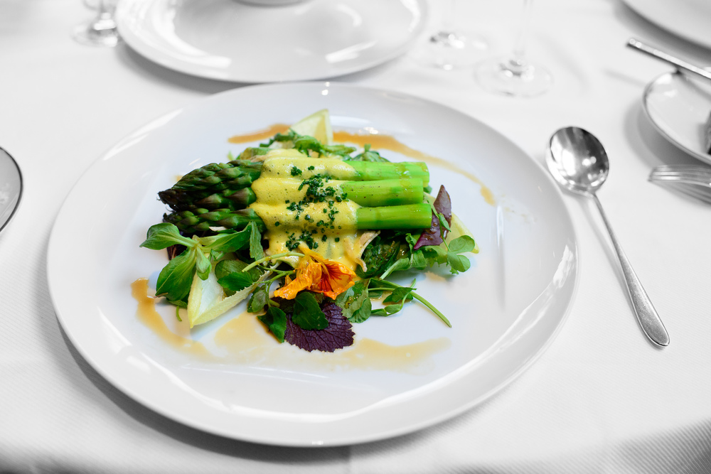 Warm green asparagus salad, hollandaise, truffle vinaigrette