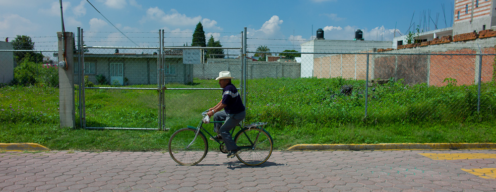 Man on Bike, Empty Lot