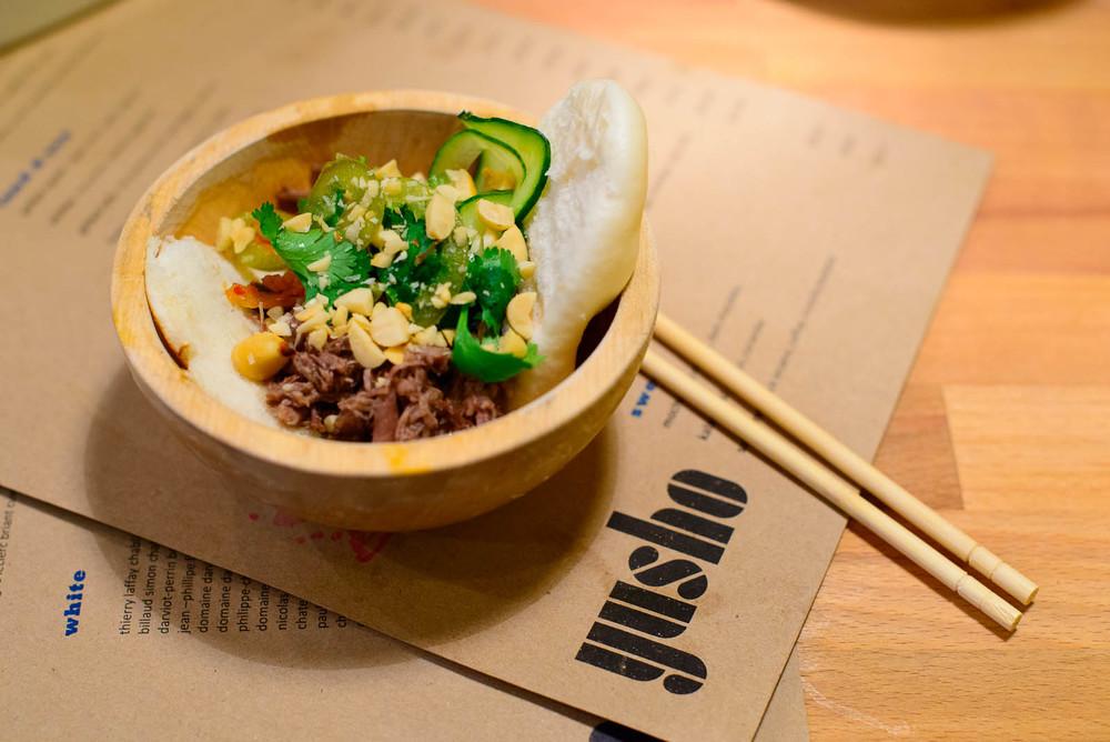 10th Course: Steamed bun, short ribs, bok choy kimchi, peanuts (