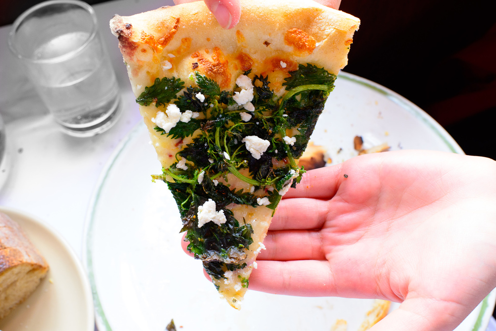 Pizza with wild nettles an ricotta salata, a slice ($18.50)