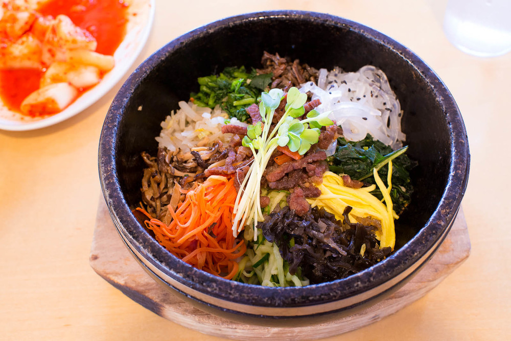 "Bibimbap (""mixed meal"") - Bowl of sizzling white rice topped wit"