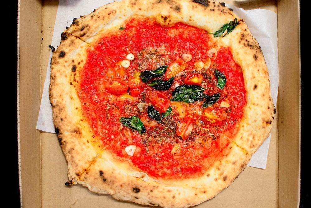 Pizza marinara - tomato sauce, garlic, oregano, pecorino ($9)