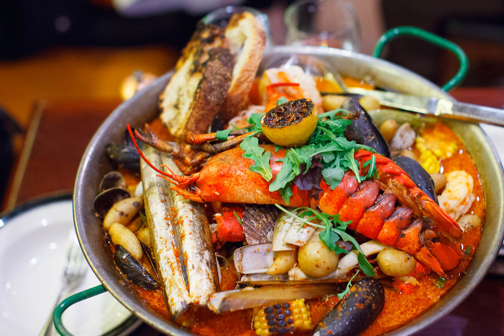 Harlem chowder - lobster, clams, potatoes, mussel broth ($64)