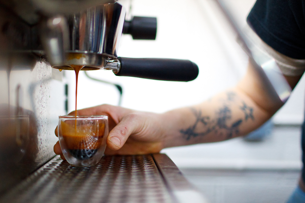 Barista Erich Rosenberg pulling an espresso from three suns beans.jpg