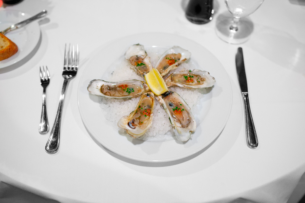 "Capers ""blades"" oysters on the half shell, smoked steelhead roe, chardonnay mignonette ($16)"
