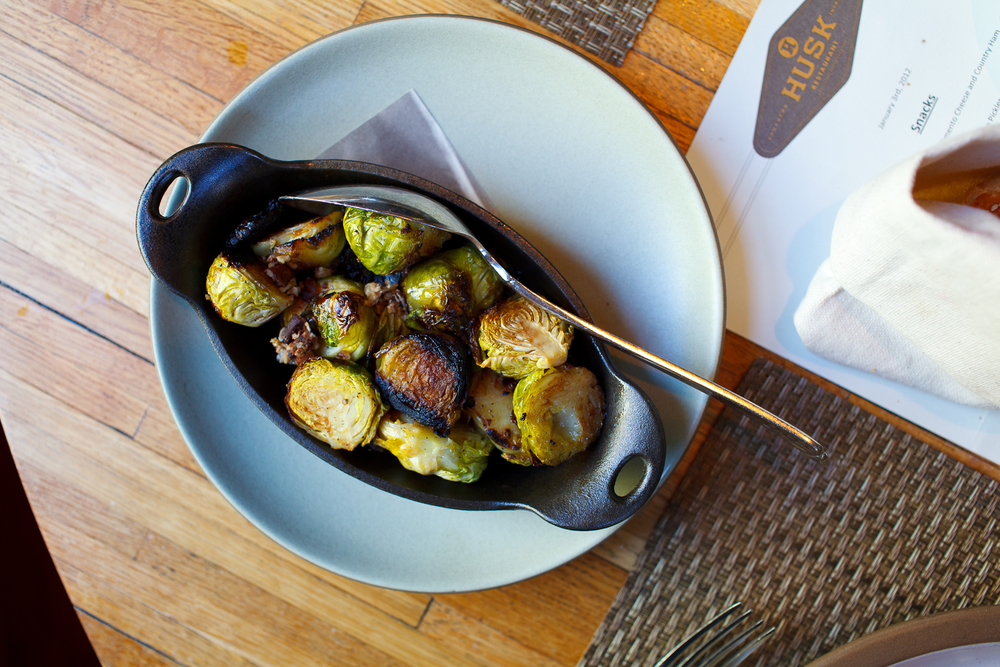 Wood fired brussels sprouts with braised pecans, sage, and Benton's bacon crumble