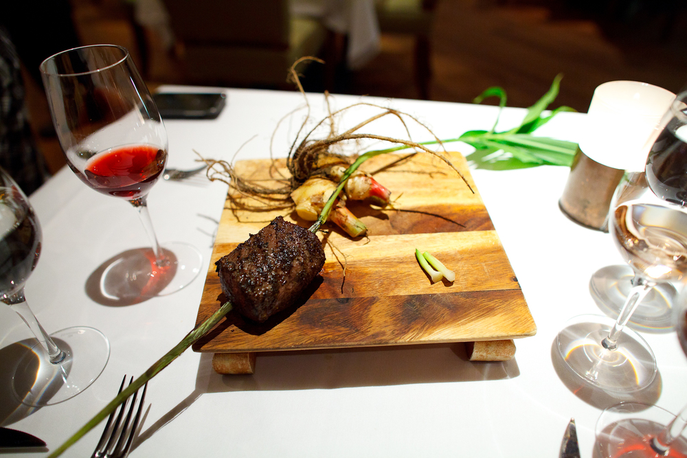 Presentation of grilled venison with young ginger stalks.jpg