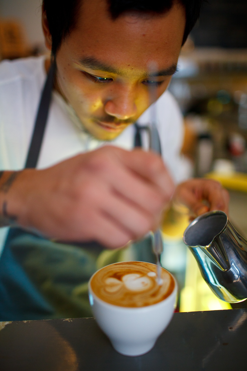 Charl making a fish on a cappuccino