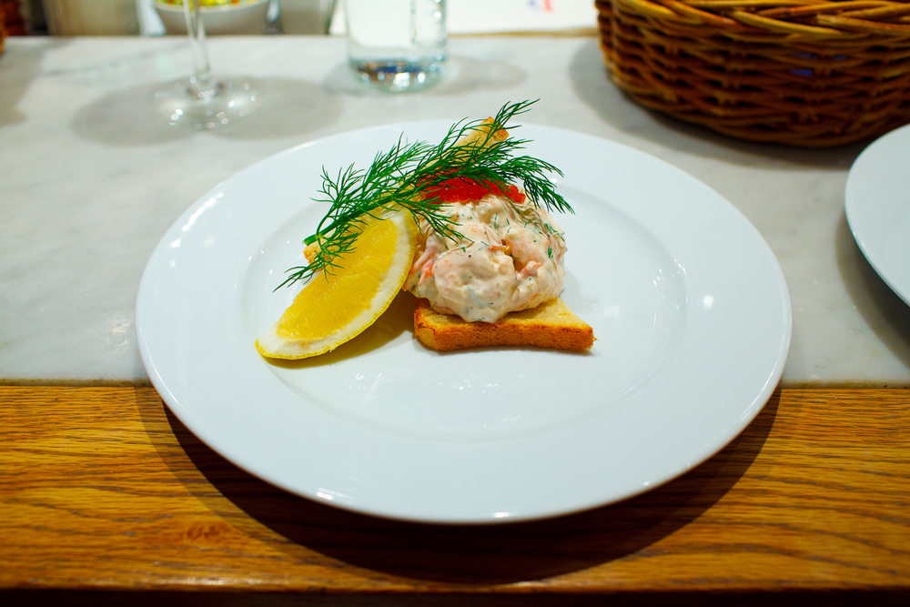 Toast skagen, 100g - Mixed shrimps, dill and mayonnaise served on toast, garnished with trout roe (135 kr).jpg