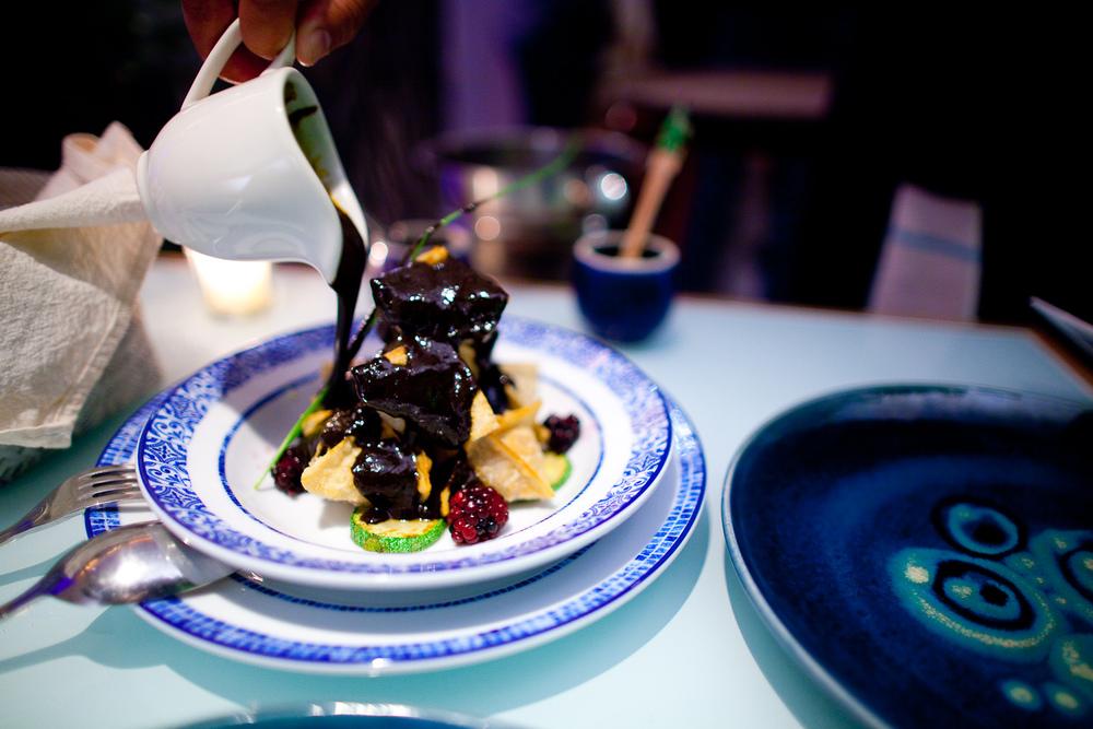 Buñuelos rellenos de pato rostizado, bañados con salsa de mole negro oaxaqueño (Mexican fritters stuffed with roasted duck in Oaxacan black mole) ($145 MXP)