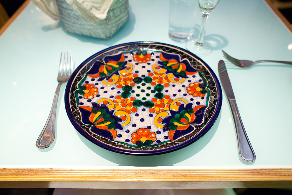 Gorgeous handmade dishware: orange, white, green, and blue plate