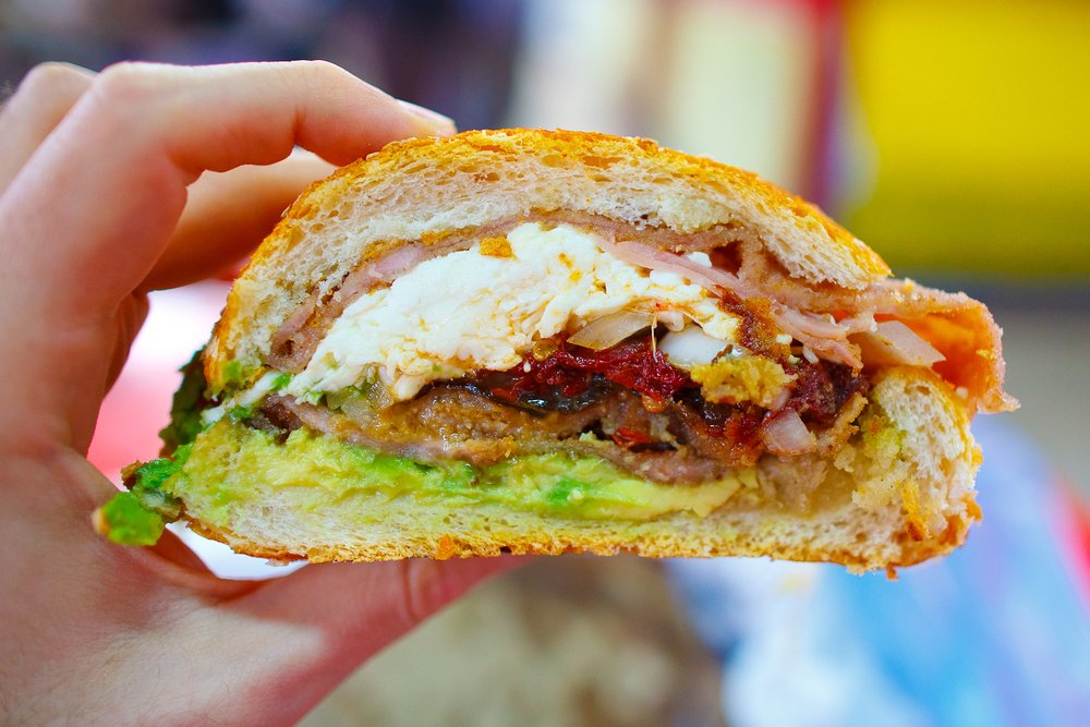 Cemita de milanesa (breaded pork sandwich, chipotle, quesillo, avocado, onion) (25 MXP)
