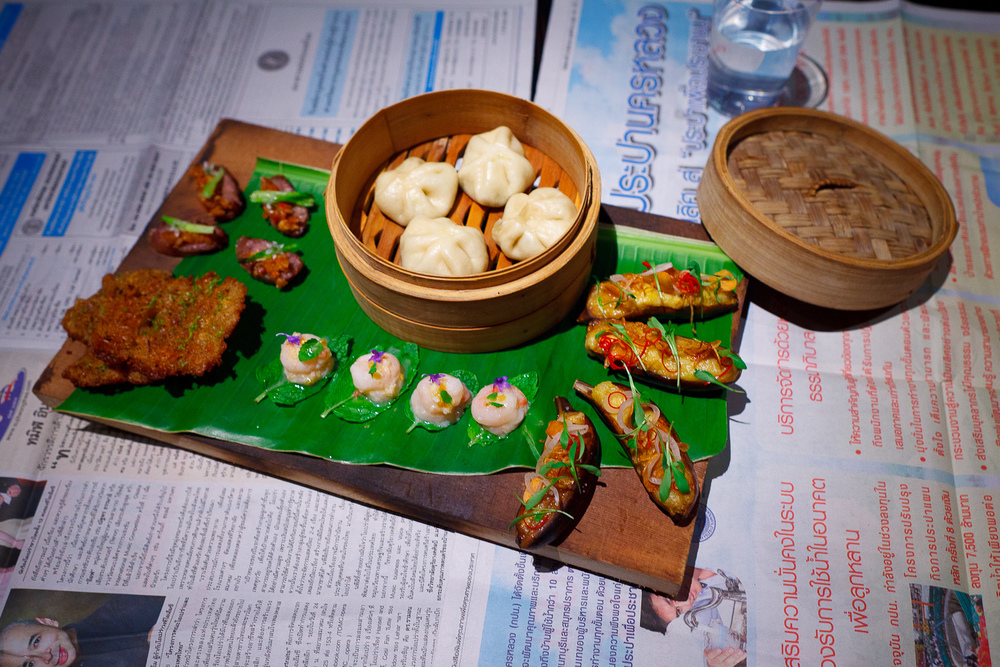 1st Course: Roasted banana (fried garlic, pickled shallot, cilantro blooms), prawn cake (white pepper, coriander, lime zest), sweet shrimp (raw garlic, mint, bird chills), fermented sausage
