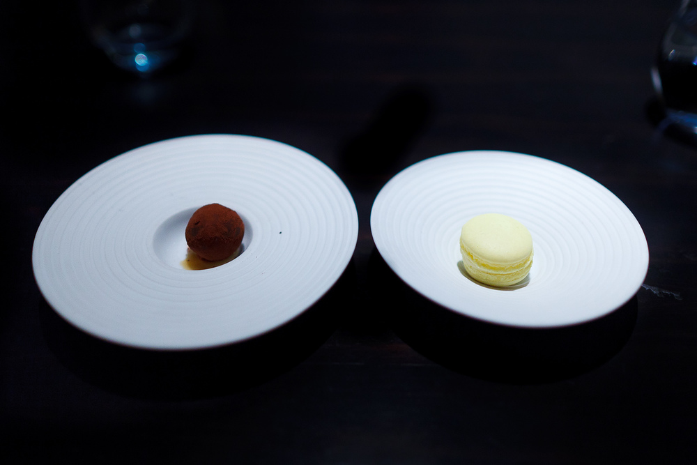 Petits fours: liquid-filled chocolate, lemon macaron