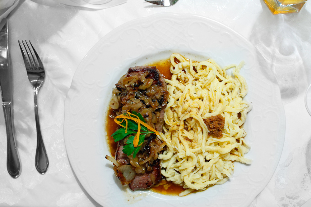 3rd Course: Zwibeltostblaten hit handgeschabten spätzle, lump steak served with fried onions accompanied by handmade spätzle (swabian noodles)