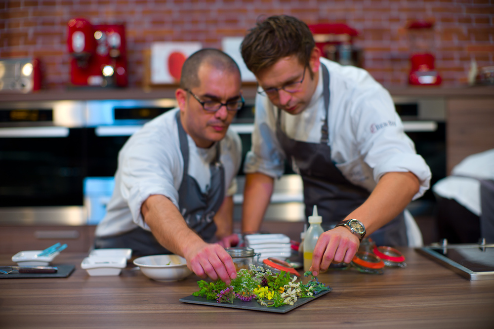 Team at La Vie, plating foraged herbs