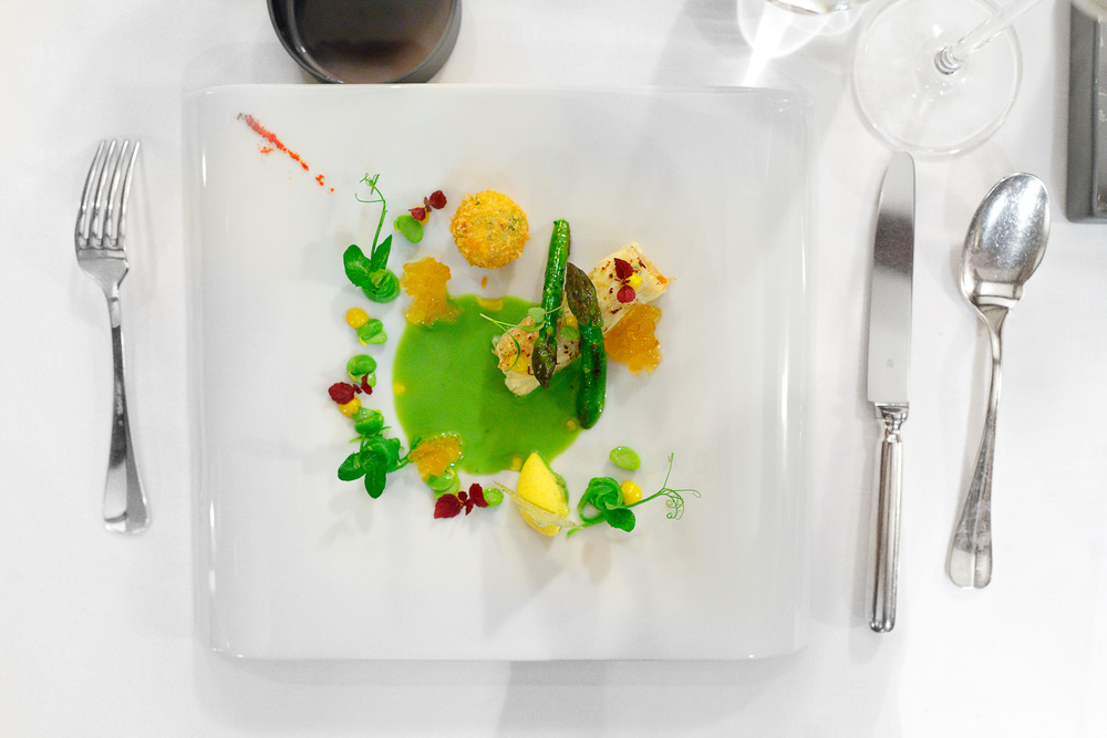 "2nd Course: ""Sea spider"" - Milk skin, green vegetable juice, curry, chrysanthemums"