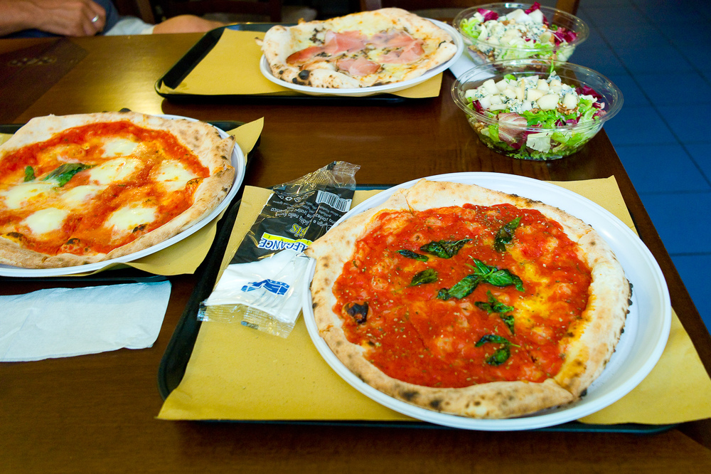 Pizza margherita, pizza marinara, pizza with speck and tomato, walnut salad
