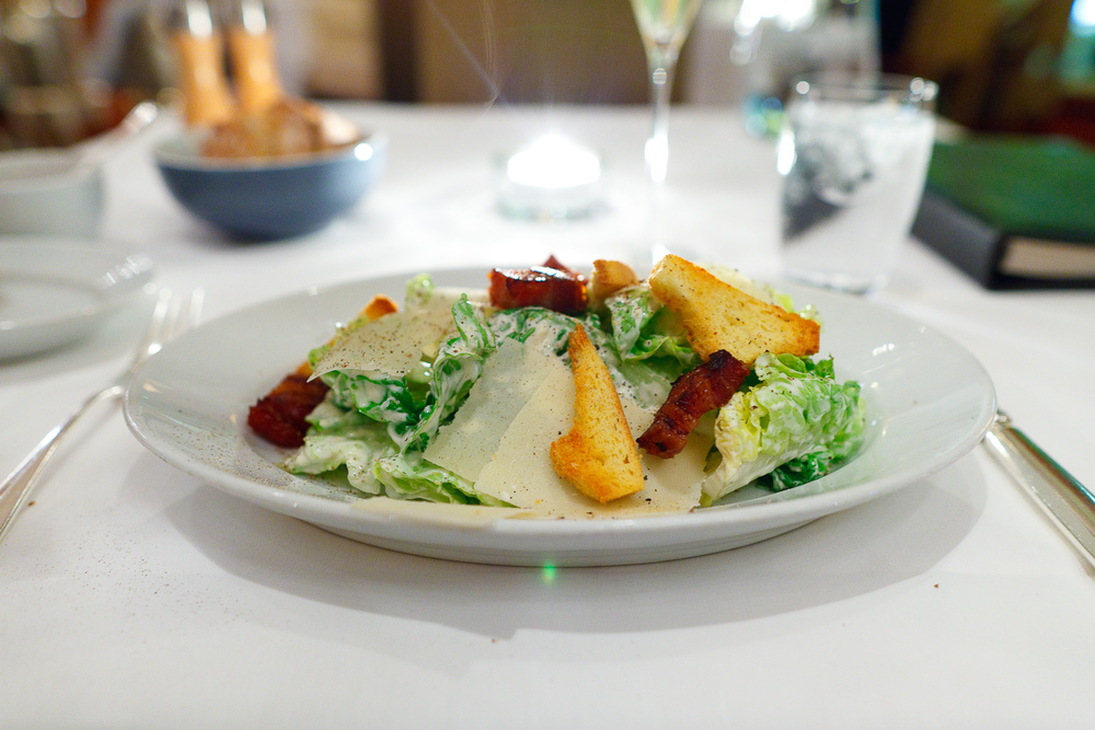 Iceberg lettuce, bacon, parmesan cheese, croutons