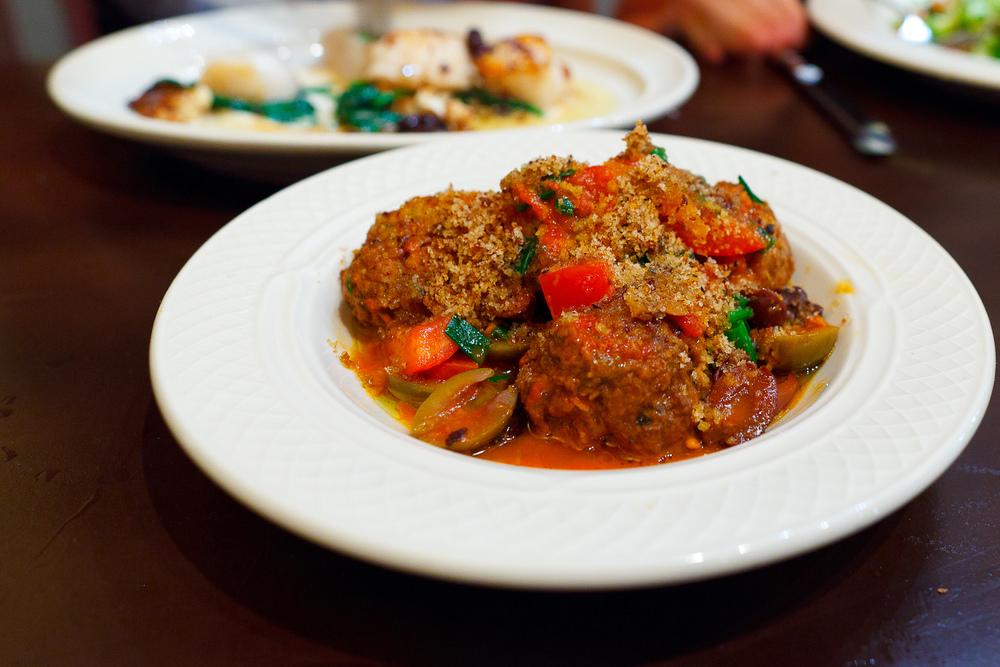 Meatballs, olive, onion, tomato sauce ($7.5)