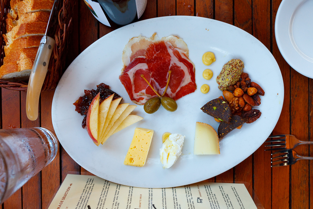 The works - Abbaye de Belloc, Laura Chenel Chèvre, and Joe Mates St. George cheese with cured meats, seasonal fruit, house-made fig cake & baguette.