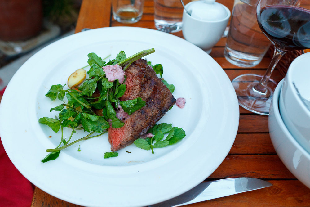 Grilled flat iron steak 8oz, roasted garden potatoes, watercress, bone marrow butter ($24)