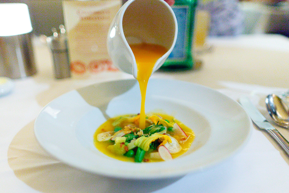 "Yellow Tomato & Summer Vegetable Soup ""Au Pistou"" pancetta, basil, parmesan cheese ($12)"