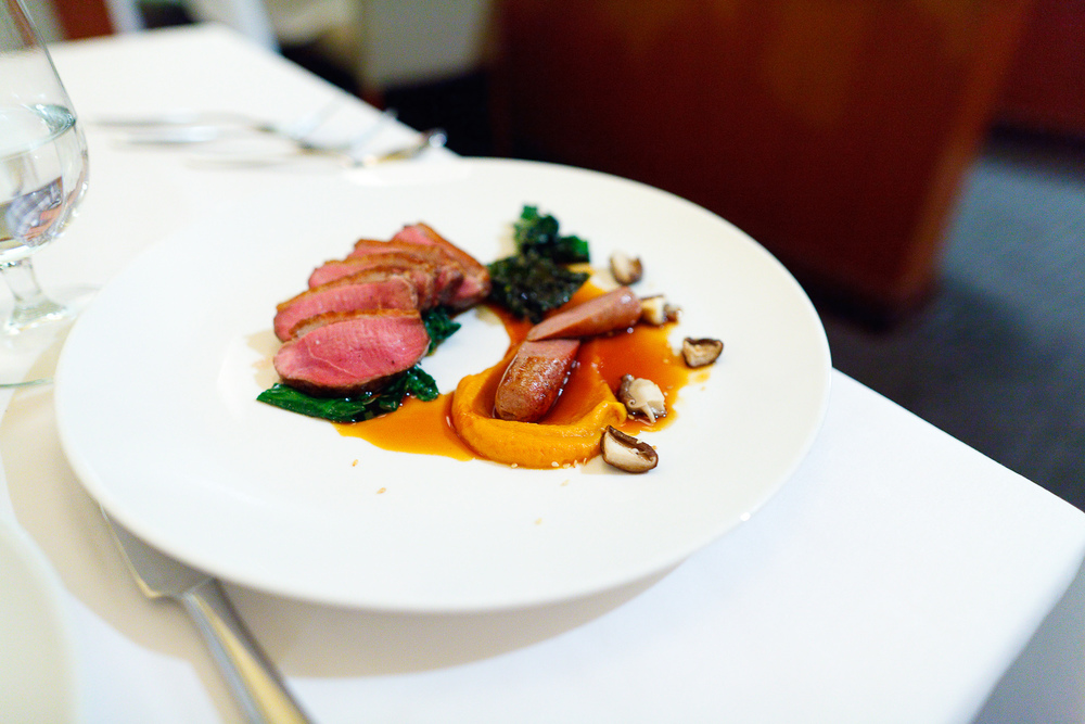 Roasted Liberty Farms Duck Breast duck sausage, sweet potato, shiitake mushrooms, sesame ($29.50)