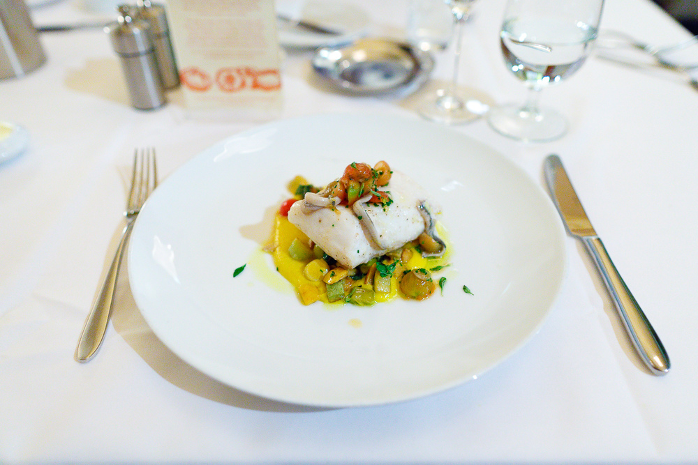 "Alaskan Halibut ""Sous Vide"" summer squash, sweet 100s, house-cured boquerones ($29.50)"