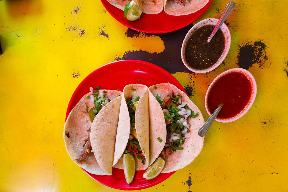 Taco de barbacoa (lamb) ($2.50), de carnitas (pork) ($2), y al pastor (pork with pineapple) ($2)