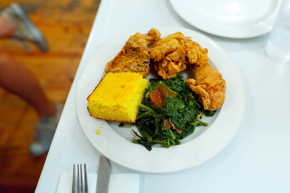 Fried chicken box, corn bread, collard greens ($13)