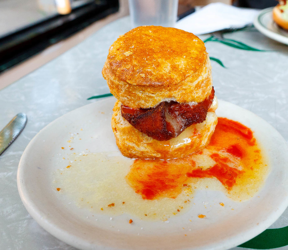 Chicken Biscuit - Homemade biscuit, breaded chicken, honey butter, hot sauce ($5.50)